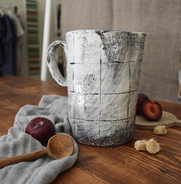 Large ceramic pitcher made by one of our favorite artists (and fellow French native), Florence Pénault.  The lines remind us of old French linens, but the finish is done is the Korean Buncheong style which dates back to the 14th century.