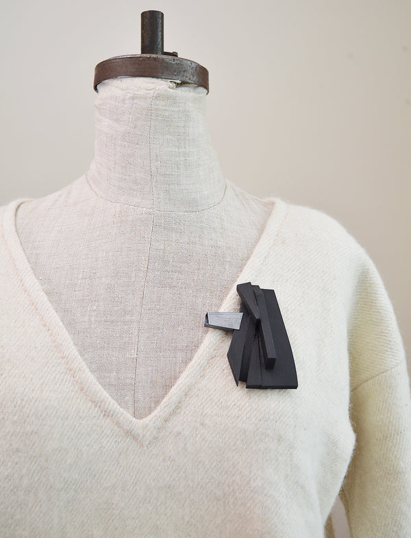 Minimal in design, Lauren Markley's jewelry is eye-catching and artistic - this unique, one-of-a-kind brooch makes a bold statement with a sculptural wood body and grey enamel accent.