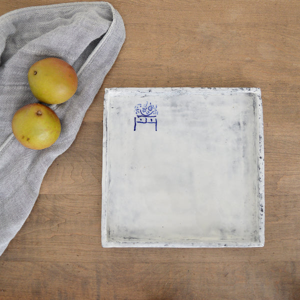square-ish plates by Florence Pénault. The hand drawn blue illustrations are an homage to the Art de la Table (Table art) and the finish is done is the Korean Buncheong style which dates back to the 14th century. Each is one of a kind.