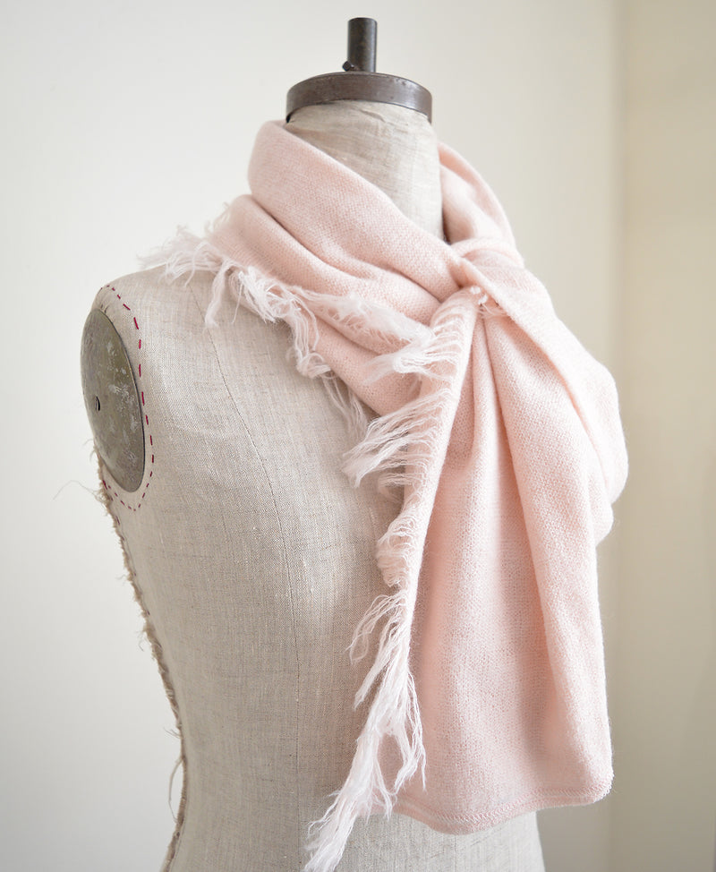 Give your winter wardrobe a touch of understated elegance with these fine alpaca scarves. Made of the softest alpaca wool, these scarves are hand knit by a collective of mothers in Peru. Warm, stylish, and versatile, they are a closet essential.
