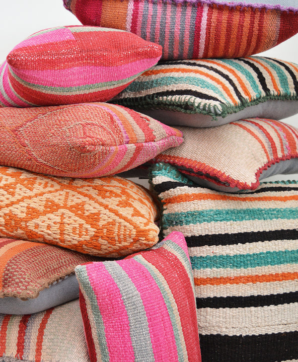 Made of vintage Peruvian blankets, these 100% wool pillows will add a pop of color to your living room.  Buy a pair and mix and match for an eclectic touch.  Each pillow is unique as it is cut from a vintage, handwoven blanket.  Organic dyes.