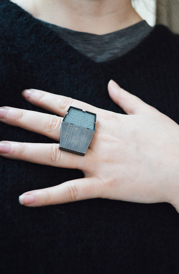 Minimal in design, Lauren Markley's jewelry is eye-catching and artistic - this unique, one-of-a-kind ring makes a bold statement with a subtle map print in grey enamel and matte stone setting.