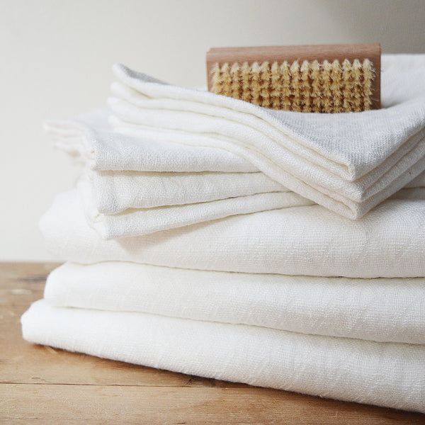 Wonderfully textured for gentle exfoliation and maximum absorbency, these quick-drying and durable diamond weave  towels are  woven from two layers of medium-weight, undyed 100% linen yarns. Whitened without the use of chlorine bleach.  Towels will arrive pressed and take on a quilted appearance after machine wash and dry, becoming softer with use.  For greater exfoliation, hang to dry.