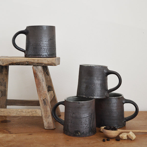 Handmade mugs by Massachussets artist Steve Theberge. Each mug is unique, one-of-a-kind. Stoneware with iron slip and wood ash glaze. Steve has exhibited at the Smithsonian Craft Show and and Philadelphia Museum of Art Craft Show. Perfect gift.