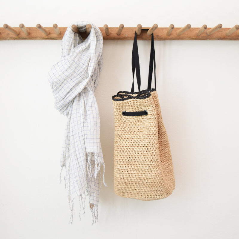Nathaly raffia backpack sling bag by Maison N.H. Paris.