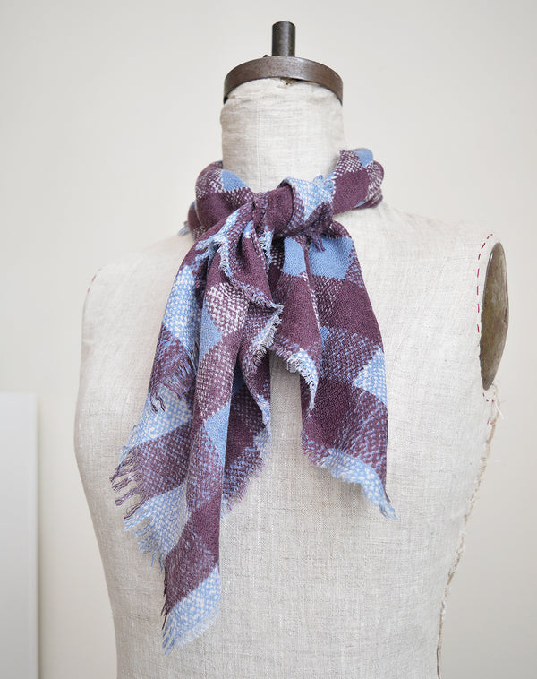 "The perfect size ""foulard"" in bold plaid patterns. Made of deliciously soft wool, silk and cashmere. Neither too big or too small, makes for the perfect accent to any outfit and the perfect Fall accessory."