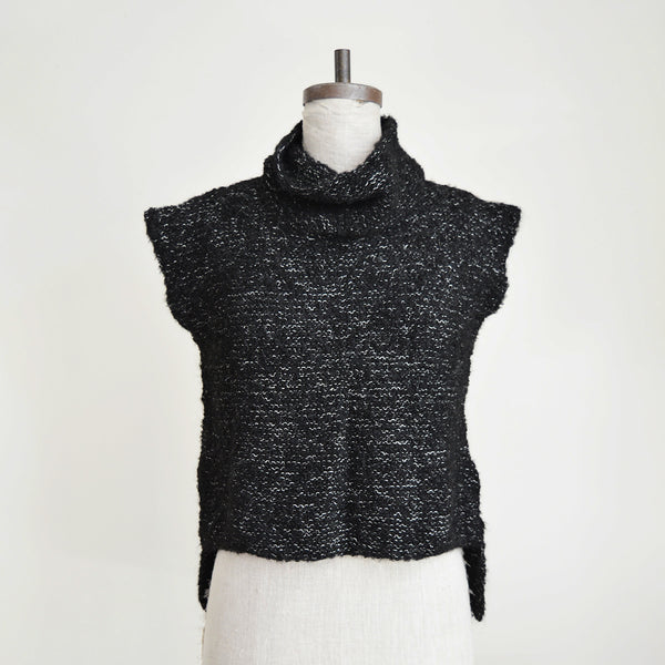 This garment was made in Peru from Alpaca wool. All MIA garments are made from organic materials and are 100% pure and natural. MIA (Mothers in Action) is a collective of Peruvian mothers who make each garment by hand.  Note that the garments are one size fits most, however there may be some slight inconsistencies in sizing due to the handmade nature of the pieces.