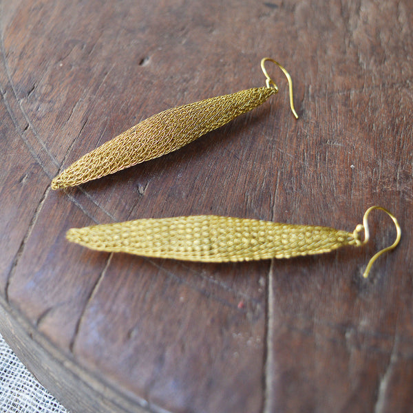 "Lotta Djossou Ligthweight wire earrings handcrafted by artisans in the island of Sumba in eastern Indonesia. Their wire wrapping technique produces delicate and timeless pieces that add a touch of sophistication to any look. About 3"" long. Sumba Island, Indonesia"