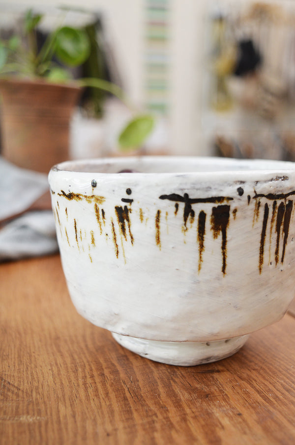 "Lovely one of a kind bowl made by Boston artist Florence Pénault. White glazed with hand-painted marks all around. Perfect to whisk your matcha as well as eating cereals or ice cream.  Approximate dimensions:  3.5"" H x 4.5"" W"