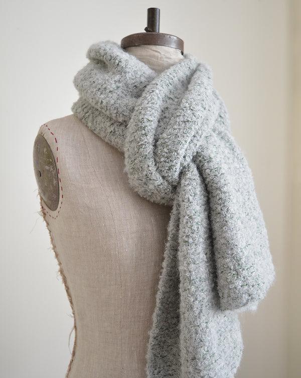 Made of the softest alpaca wool, these scarves are hand knit by a collective of mothers in Peru. Super thick and chunky (perfect for the coldest weather) in a gorgeous grey wool with green detailing.