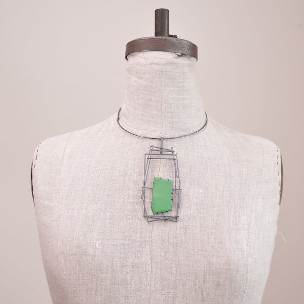 Minimal in design, Lauren Markley's jewelry is eye-catching and artistic - this unique, one-of-a-kind necklace makes a bold statement with a grey enamel setting and an enamel pop of color.