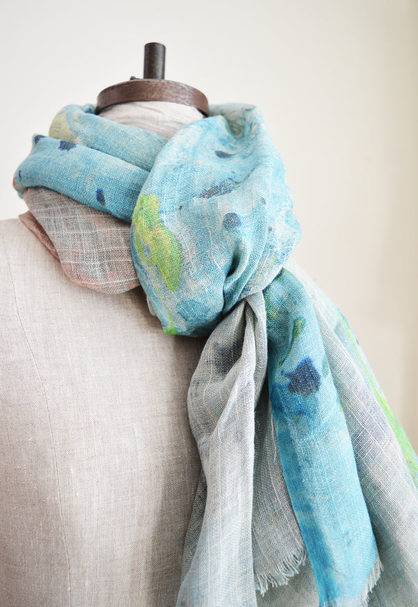 Martyn Thomspon linen scarf with a paint splatter design, can beworn as a scarf, sarong, or shawl.