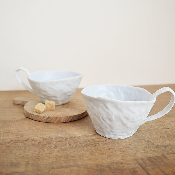 Hand pinched porcelain latte cup or tea cup by Maine potter Ingrid Bathe. Available in Boston shop.