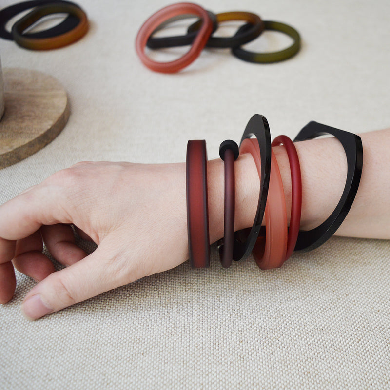 Alex and Svet Acrylic and Rubber bracelets. Contemporary Modern Jewelry Handmade in Paris. Mix and Match to make your own statement