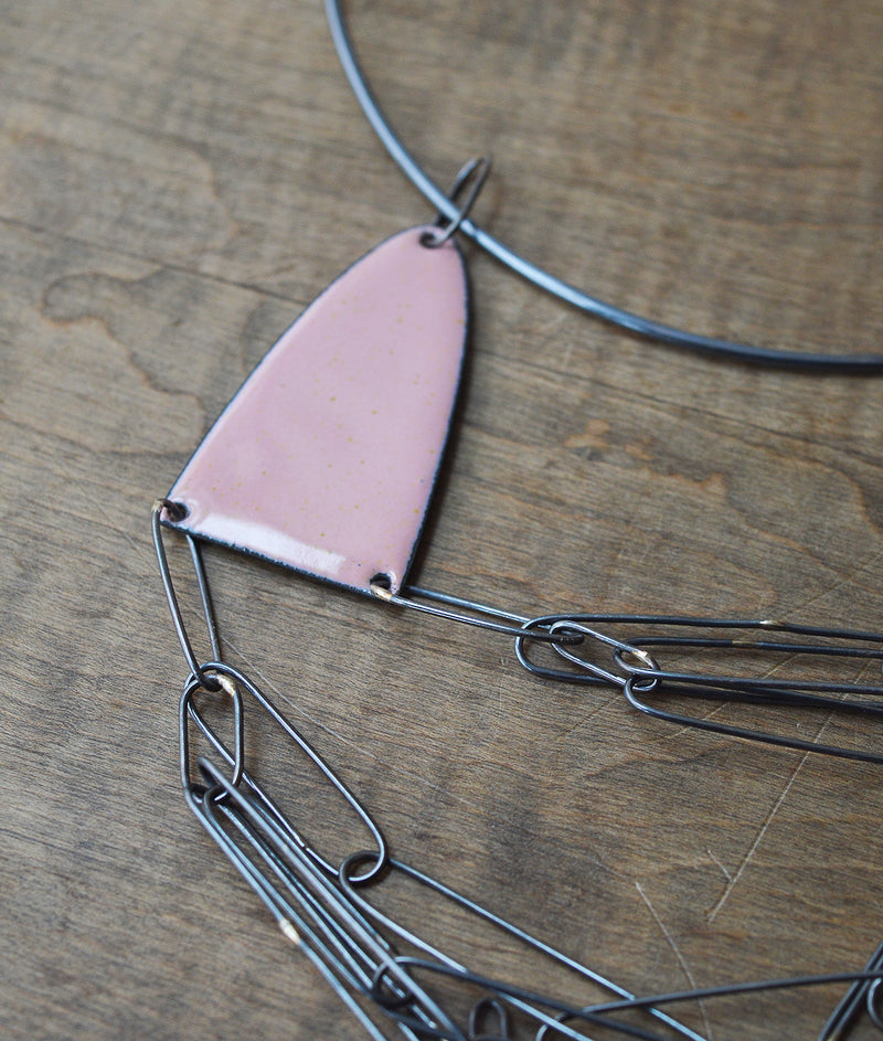 Minimal in design, Lauren Markley's jewelry is eye-catching and artistic - this unique, one-of-a-kind necklace makes a bold statement with a subtle pop of pink.