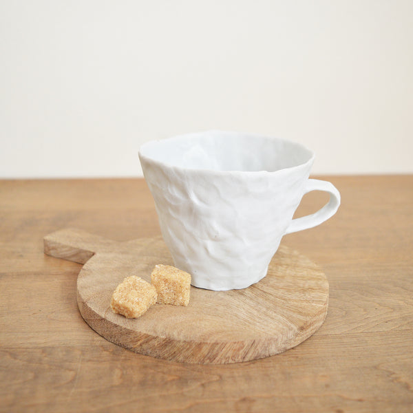 Hand pinched porcelain teacup by Maine potter Ingrid Bathe. Available in Boston shop.