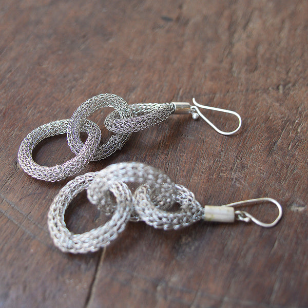 "Lotta Djossou Chainlink Earrings - Ligthweight wire earrings handcrafted by artisans in the island of Sumba in eastern Indonesia. Their wire wrapping technique produces delicate and timeless pieces that add a touch of sophistication to any look. About 3"" longSumba Island, Indonesia"