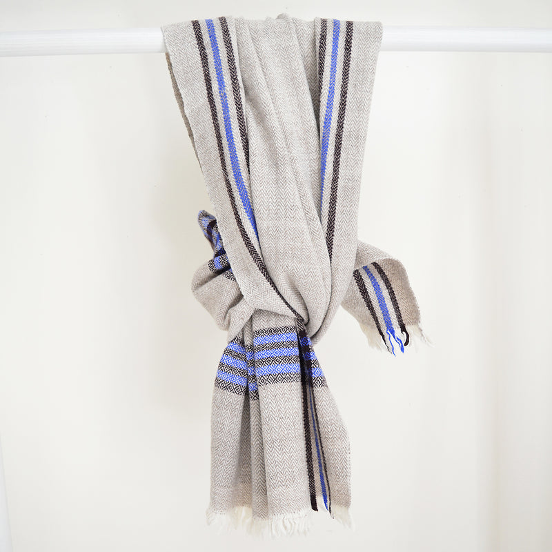Super soft, 100% cotton khadi (homespun yarn and handwoven) throws in gorgeous plaid patterns. Made in India, these soft throws are perfect for cozying up this fall and winter while the bright colors make it a perfect throw to display year-round.  Choose from a pop of blue or  neutral white detailing. Made in India.