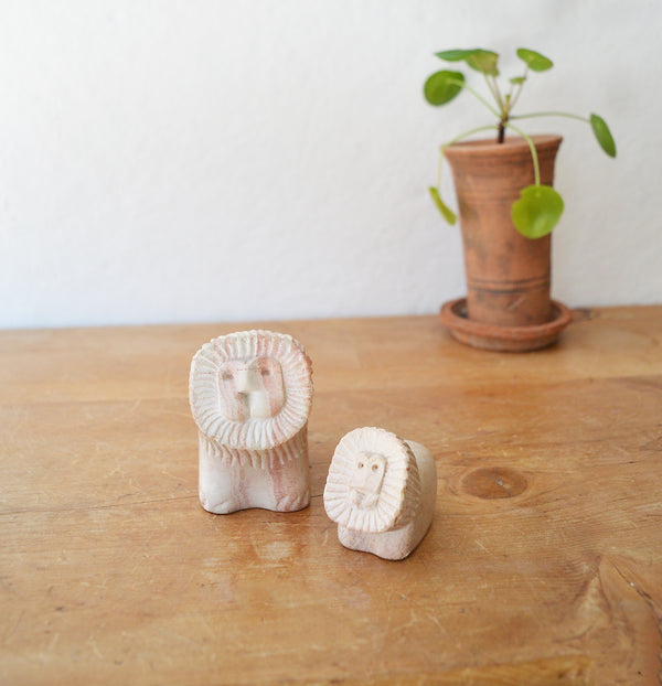 MCM Mid century modern  hand carved limestone travertina sculptures of a lion and her cub.