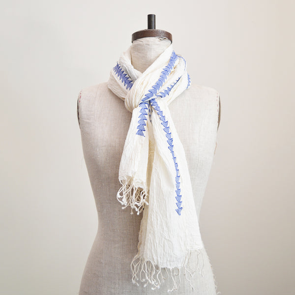 Airy natural color cotton scarf with delicate woven blue arrow border. Slightly crinkled cotton gives a little extra volume. 100% cotton khadi