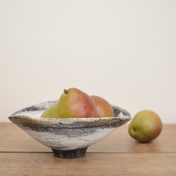 One of a kind ceramic bowls by Florence Penault new in the Boston shop. These are all finished with a dark glaze onto which a lose white brushstroke is artfully applied. The finished glaze is reminiscent of a 14th century Korean technique, called Buncheong.