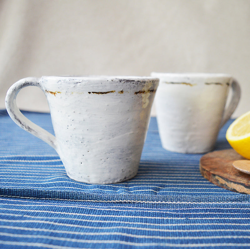 One of a kind mugs made by one of our favorite artists (and fellow French native), Florence Penault.   The finish is reminiscent of the Korean Buncheong style, which dates back to the 14th century.  Get a pair as a gift for your favorite couple, or treat yourself!