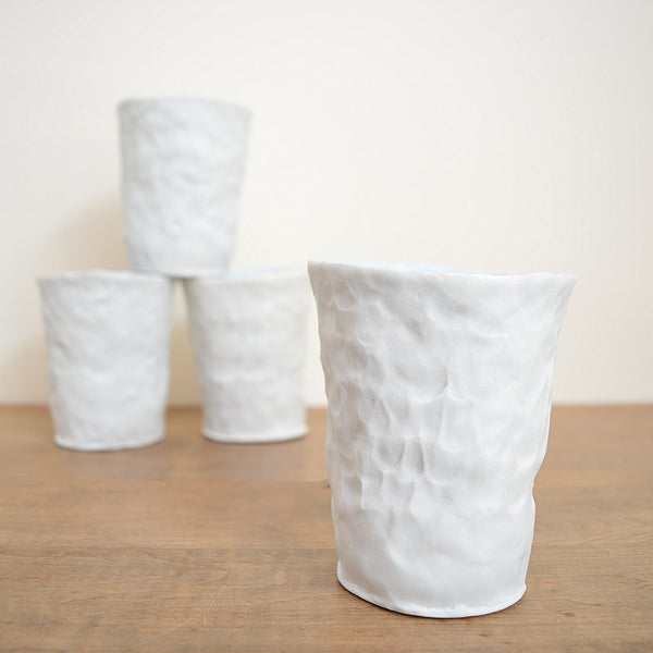 Hand pinched porcelain tumbler by Maine potter Ingrid Bathe. Available in Boston shop.