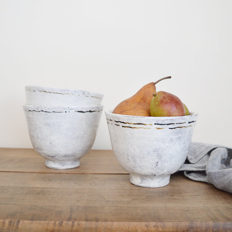 Tall, hand-made ceramic bowls by Boston - based, French artist Florence Penault.  Good for eating ramen, or as serving bowls on the dinner table.