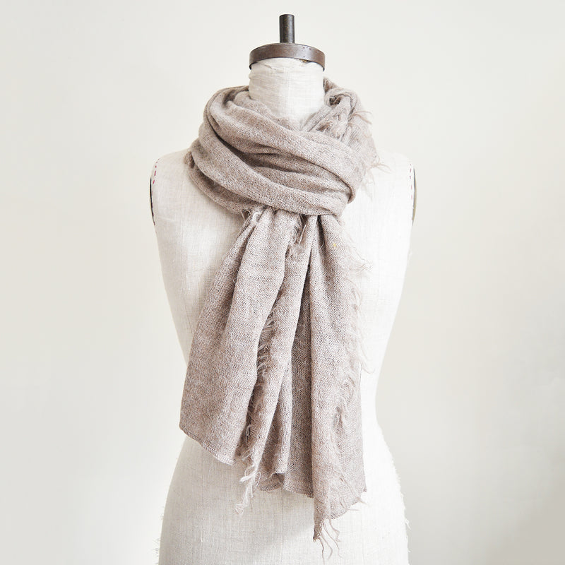Made of the softest alpaca wool, these scarves are hand knit by a collective of mothers in Peru. Warm, stylish, and versatile, they are a closet essential.