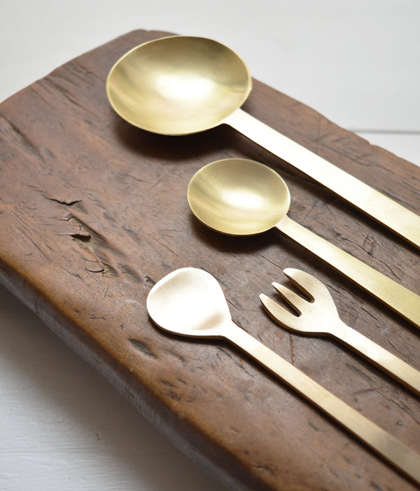 Brass Dessert Spoon Hand-hammered brass spoons with a matte finish. Perfect as serving utensils and they make wonderful house-warming gifts. As each is hand-made, surfaces may not be uniform.