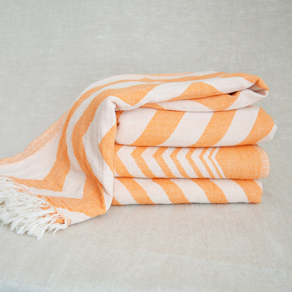 Hand loomed and hand dyed by skilled artisans, this Turkish towels / throws are known for their softness, durability and versatility.  Perfect to travel as they requires less space than a regular towel.   Can be used as a throw, blanket, towel, sarong, etc. Orange Chevron Pattern