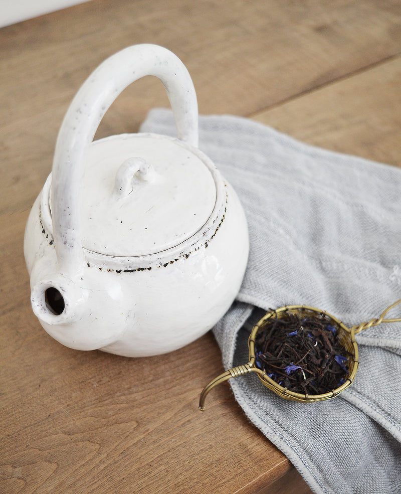One of a kind ceramic teapot made by Boston artist Florence Pénault. White glaze with a tiny hand-painted black dots around the top. Ideal for one cup of tea.