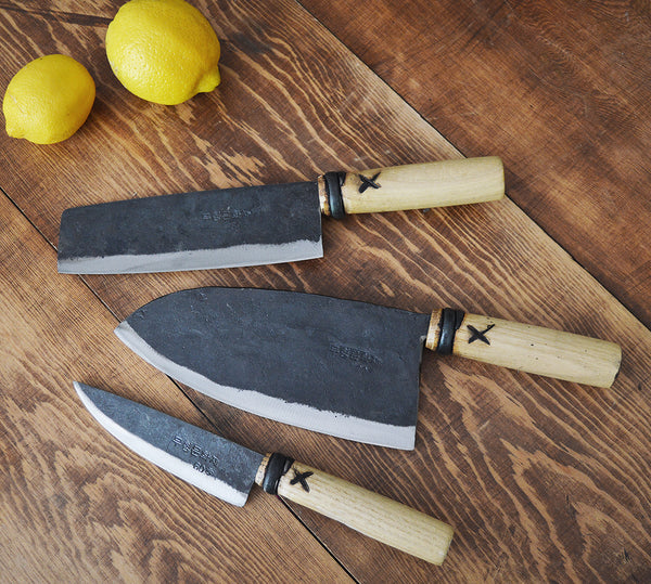 Beautifully crafted kitchen knives from the oldest Korean blacksmithing workshop (Shin, 5th generation, established in 1845) Master Shin makes roughly 40 different designs of knives and farm tools. He uses railroad track, repurposing the carbon steel which is rich is manganese and can be heated to a very high temperature. This steel is hardened, wear-resistant and good for cutting. The handles are made of chestnut, slowly dried in sunlight for years so it is lightweight, strong and rot-resistant.