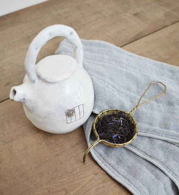 One of a kind ceramic teapot made by Boston artist Florence Pénault. White glazed with a hand-painted black square drawing on one side. this charming teapot is perfect for one serving of  your favorite tea.