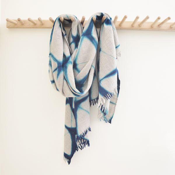 Our collection of indigo throws feature 100% wool khadi (homespun yarn and handwoven), in deep hand dyed shades of indigo in a variety of gorgeous patterns. Each piece is deliciously soft (certainly soft enough to wear as a wrap or scarf) and unique.   Made in India