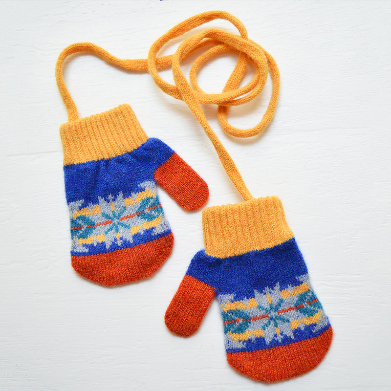 Warm kid's mittens made from the softest merino wool in a variety of playful patterns. These colorful mittens are attached on a string to keep the pair from losing a mate. Ideal for ages 2-4.  Designed in London, Made in Scotland. 100% Merino Lambswool