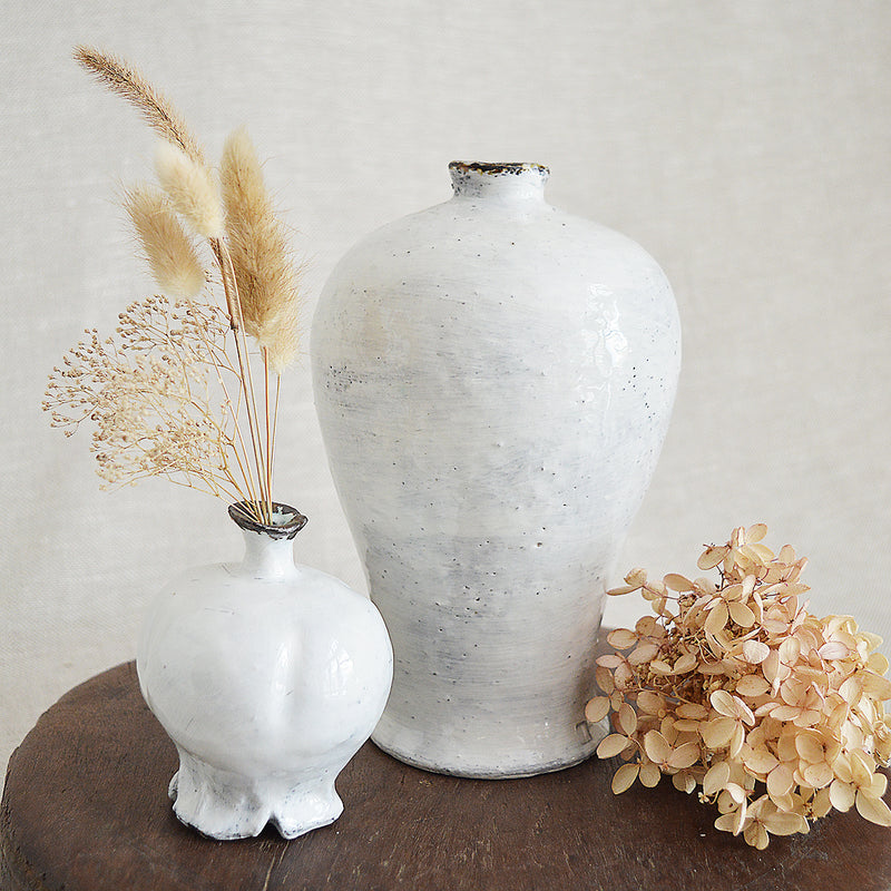 Large ceramic vase made by one of our favorite artists (and fellow French native), Florence Penault. Its simple and timeless vase will complement any decor and make the perfect wedding gift. Buncheong style finish.