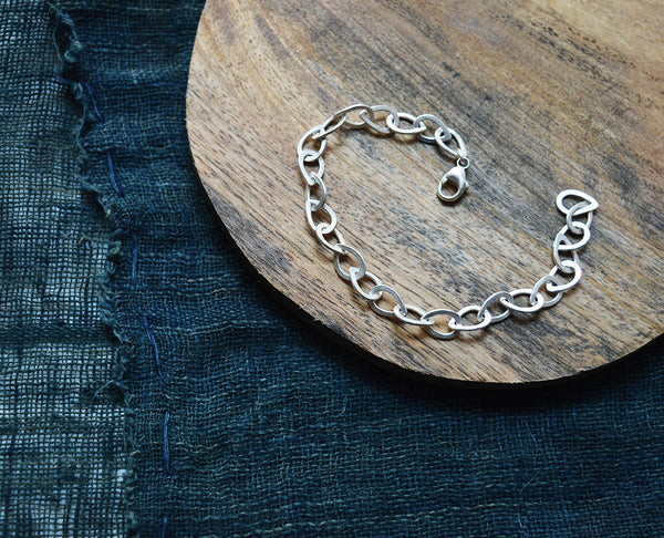 Elegant links in the shape of tear drops make this chain bracelet quite unique. Each link is made and soldered by hand by San Francisco artist Siedra Loeffler.
