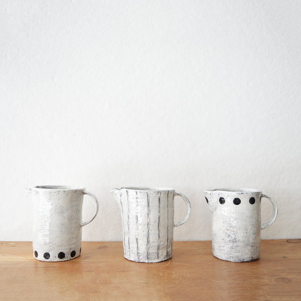 New handmade ceramic pitchers by Florence Pénault.  Use them as a regular pitcher or as a vase.  Choose from 3 styles from drop down menu. The finish is done is the Korean Buncheong style which dates back to the 14th century.