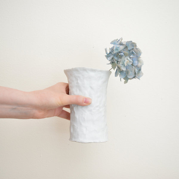 Hand pinched porcelain vase by Maine potter Ingrid Bathe. Available in Boston shop.