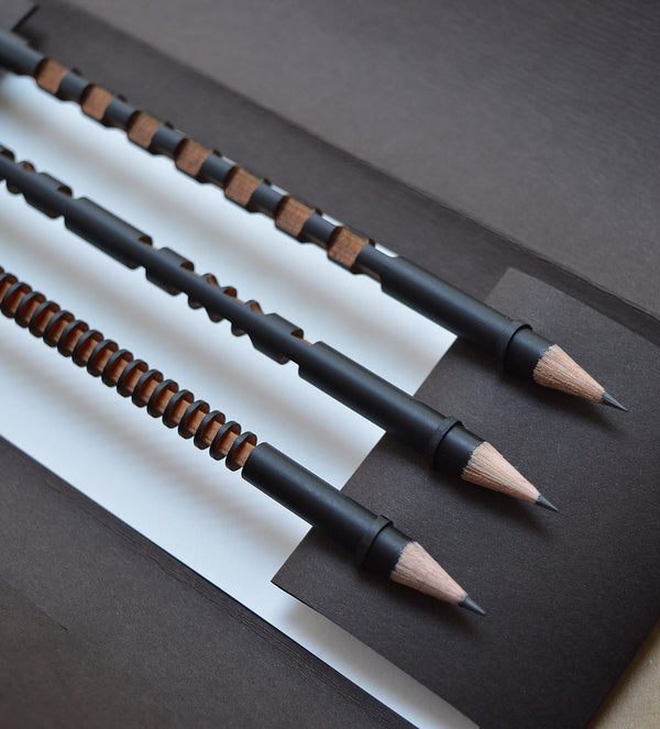 Inspired by the art of Brancusi as well as African sculptures, these wooden HB pencils  have intricate laser cut designs that makes them as interesting to use as to look at.    Each set includes 3 pencils packaged in a beautiful paper case. Solid Limewood, HB, matt black lacquered.