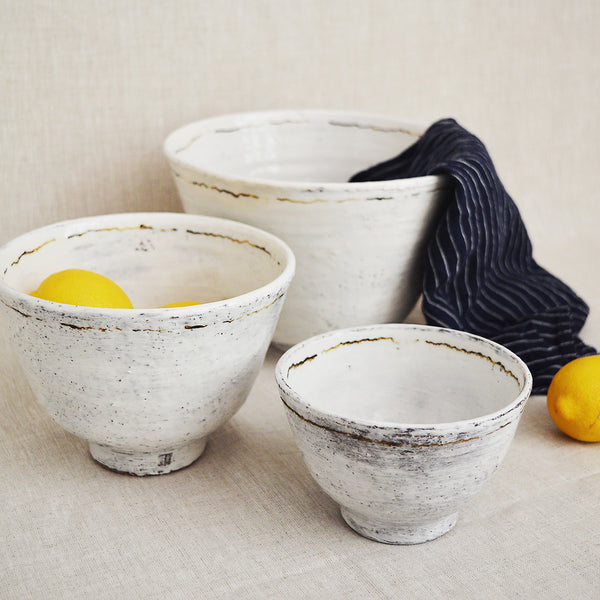 Handmade white glazed speckled ceramic nesting bowls