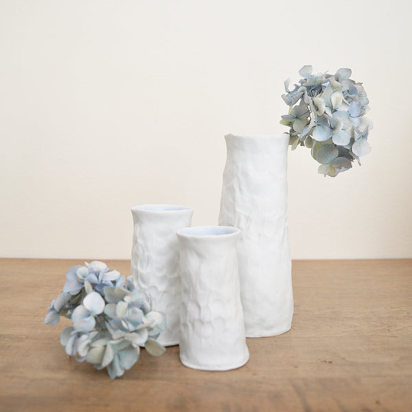 Hand-pinched Porcelain Bud Vase by Maine Potter Ingrid Bathe. Available in Boston shop