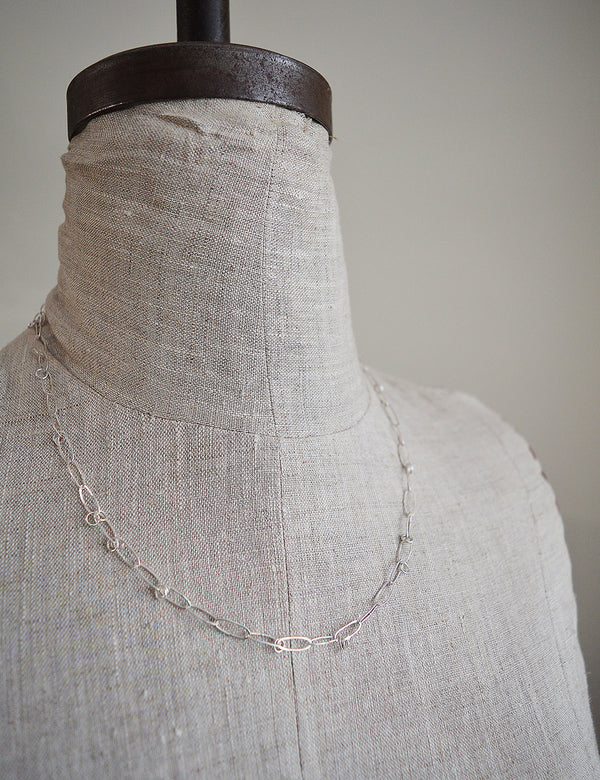 One of a kind sterling silver chain by San Francisco artist Siedra Loeffler.   Oval links are adorned by little round rings creating an original chain necklace.  Each link  and ring is formed and soldered by hand.