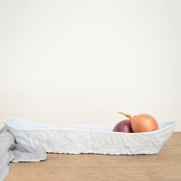 Hand-pinched Porcelain Elongated Serving Platter by Maine potter Ingrid Bathe. Available in Boston shop.