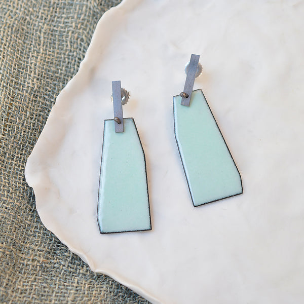 Minimal in design, but add a bright pop of color in olive and aqua. Lauren Markley's jewelry is eye-catching and artistic - these elegant enamel earrings (with a sterling silver bar and post) make a playful statement with a bold pop of fun color.