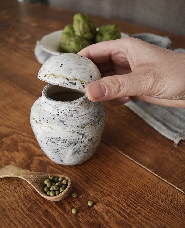 A truly special, one-of-a-kind container with lid made by one of our favorite artists (and fellow French native), Florence Pénault. Perfect to store tea, sugar, jam, really anything as long as it's delicious. Finished in the Buncheong style, a 14th century Korean glazing technique.