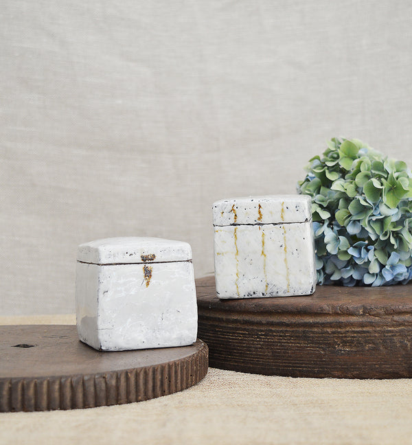 Unique handmade ceramic boxes by Florence Penault.   Perfect in the kitchen as a salt cellar or tea caddy, but are so elegant that that they will look great in the bedroom to store jewelry or any necessary item on your bed side table. The finished glaze is reminiscent of a 14th century Korean technique, called Buncheong.