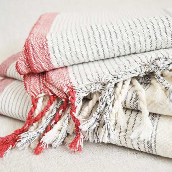 Hand loomed and hand dyed by skilled artisans, this Turkish towels / throws are known for their softness, durability and versatility.  Perfect to travel as they requires less space than a regular towel.  Natural stripe with red border and fringe