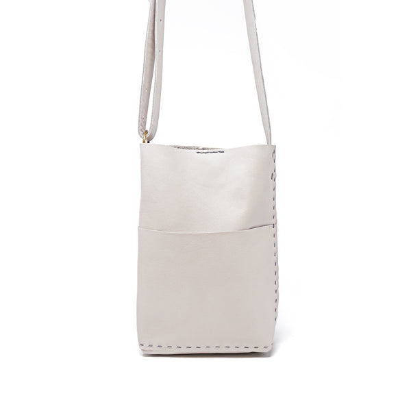 The Molly is the perfect travel bag. It easily fits a small water bottle, a tablet, wallet and glasses. Can be worn over the shoulder or as a crossbody. Adjustable strap.